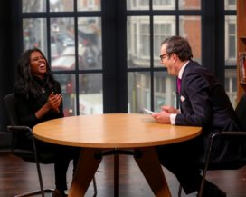 Shot of Michael Hayman DBE, Change Makers host, laughing with interview guest